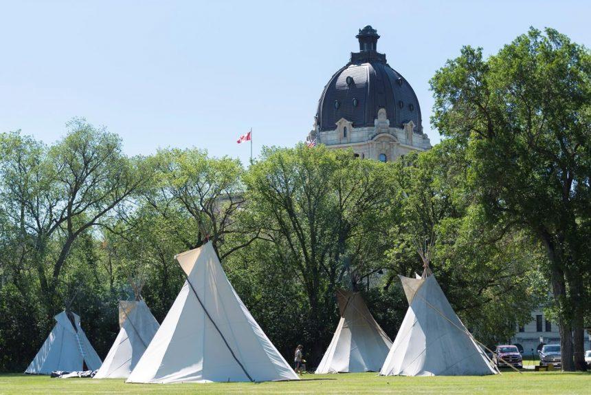 Saskatchewan Premier Scott Moe wants Regina police to remove teepees from park