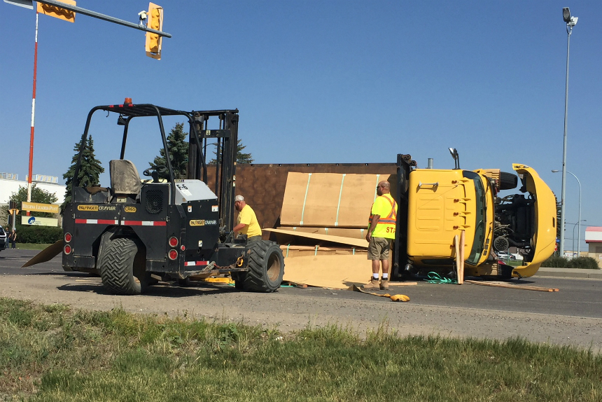 Tipped over lumber truck causes Regina traffic restriction