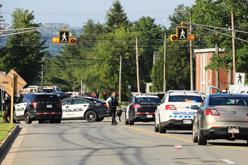 Two officers among four people dead in New Brunswick shooting