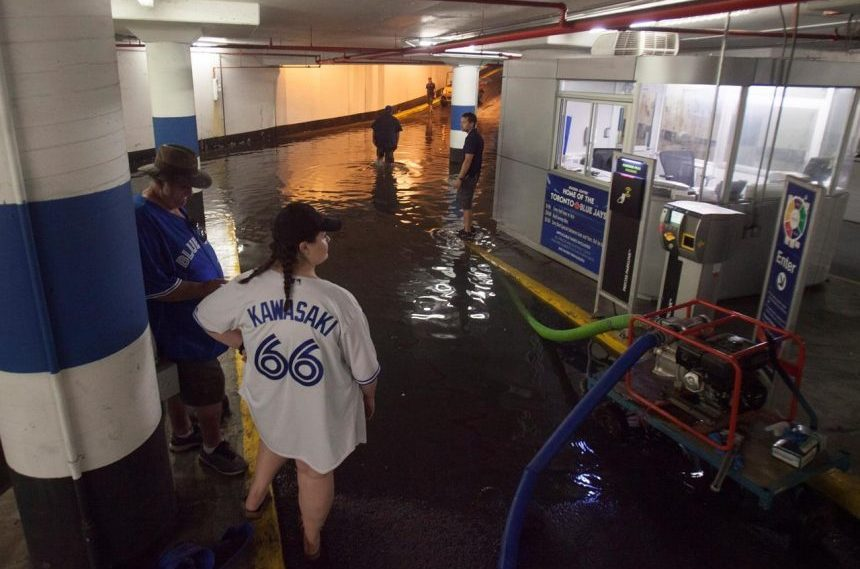 Close call for two men in flooded elevator during heavy rain in Toronto