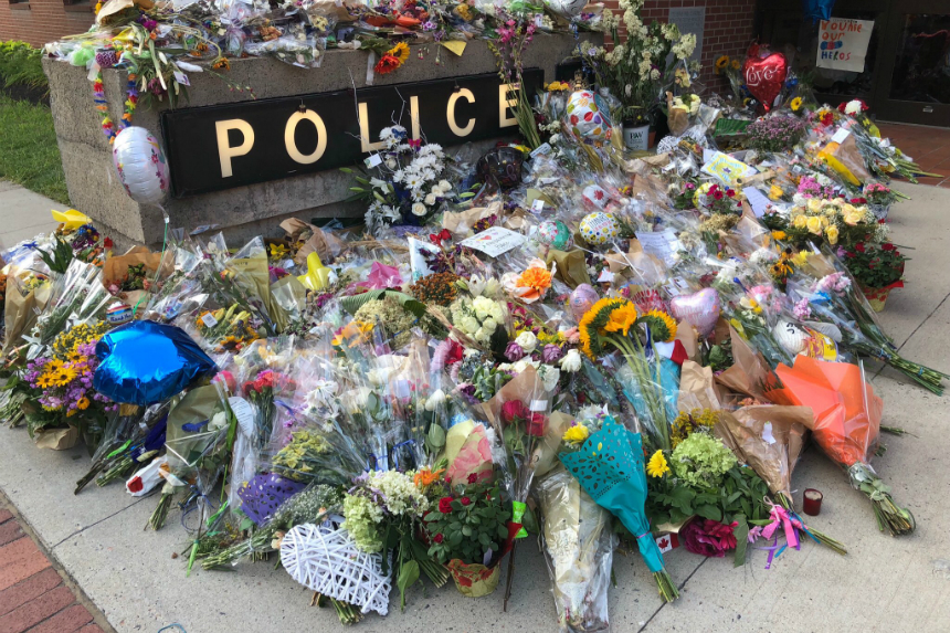 Fredericton police collect cards, flowers left at makeshift memorial