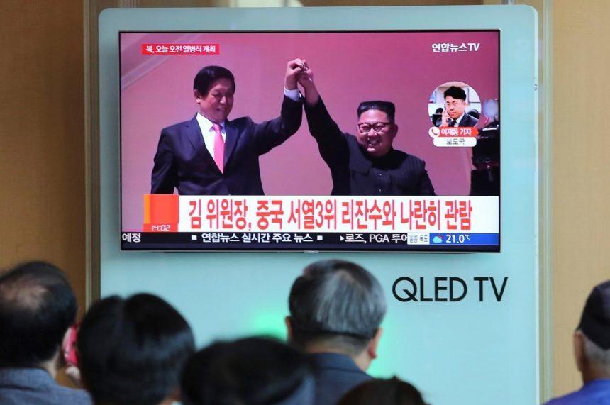 N. Korea stages huge parade, holds back on advanced missiles