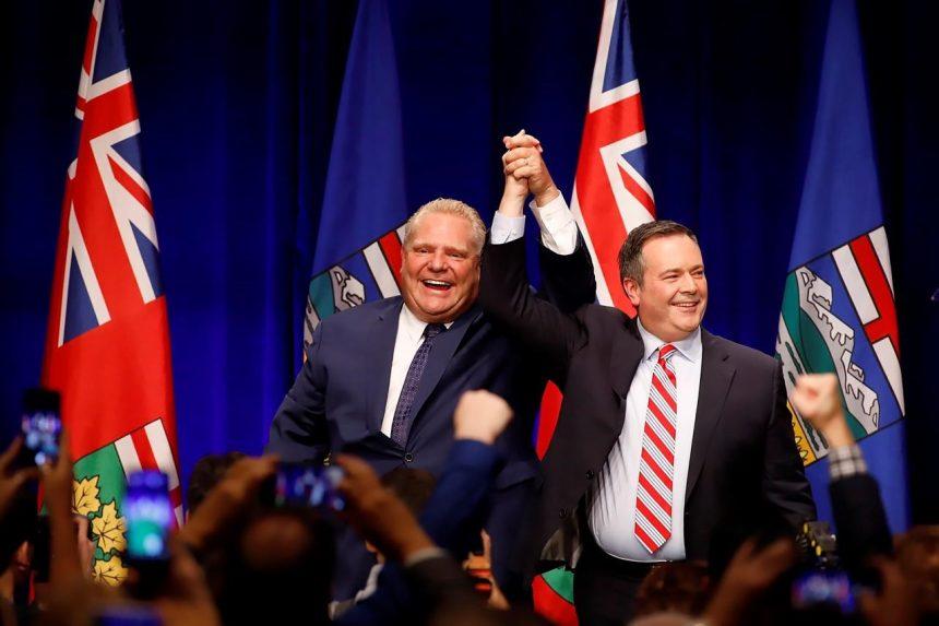 Raucous crowd hears Ford, Kenney rail against carbon tax at Calgary rally