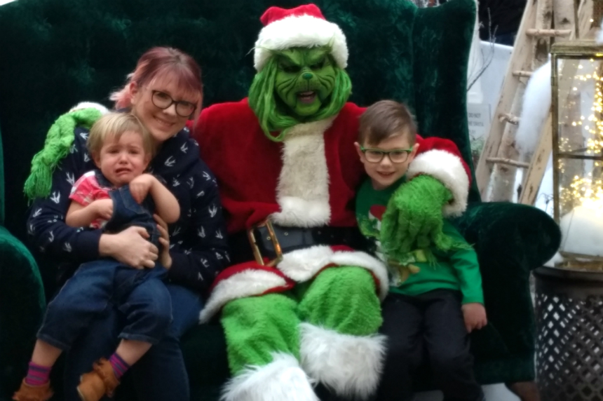 Popular photos with the Grinch spark some smiles and tears