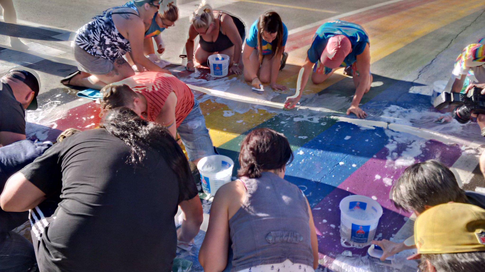 Volunteers gather to clean up Pride crosswalk