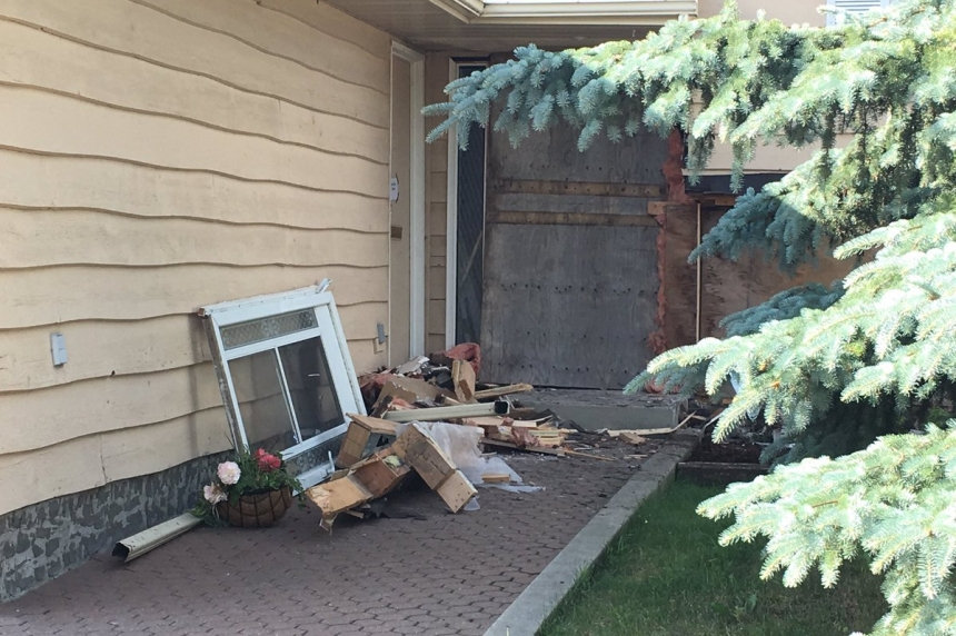 No charges after SUV plows into house