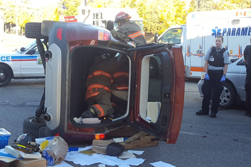 Firefighters pull one person out of vehicle after collision
