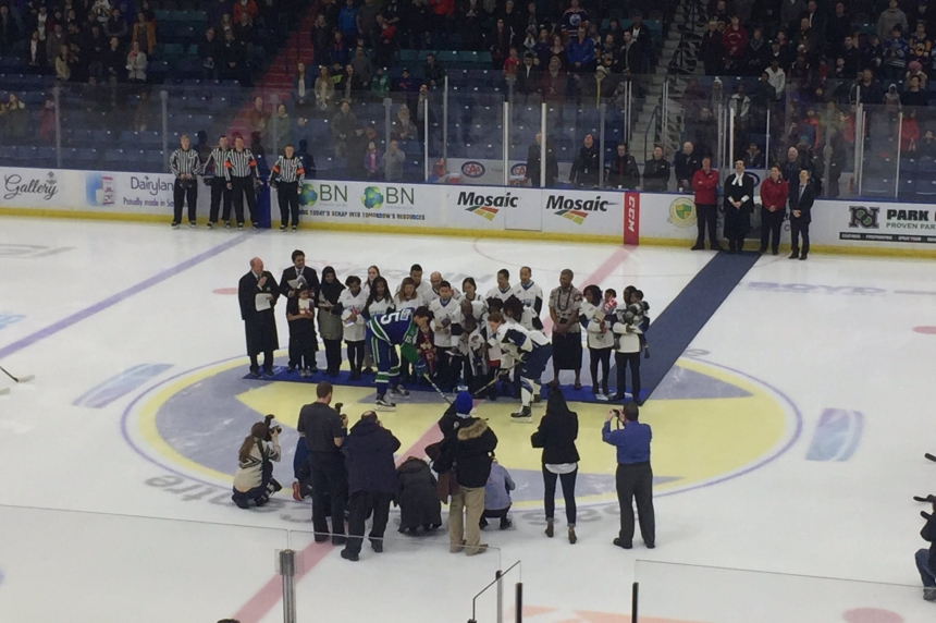 New Canadians take citizenship oath at Blades game