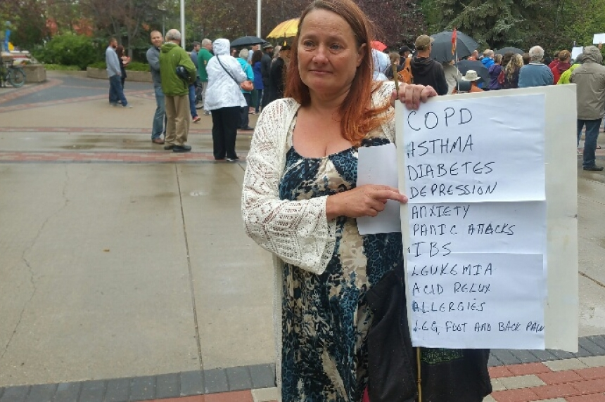 Demonstrators oppose provincial cuts to benefits for the disabled