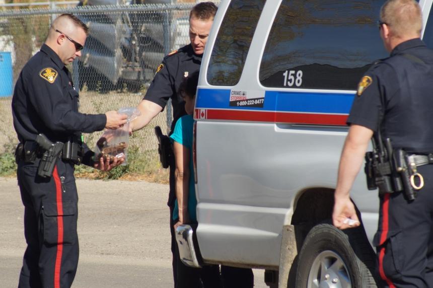Police surround home on Avenue I South in Saskatoon
