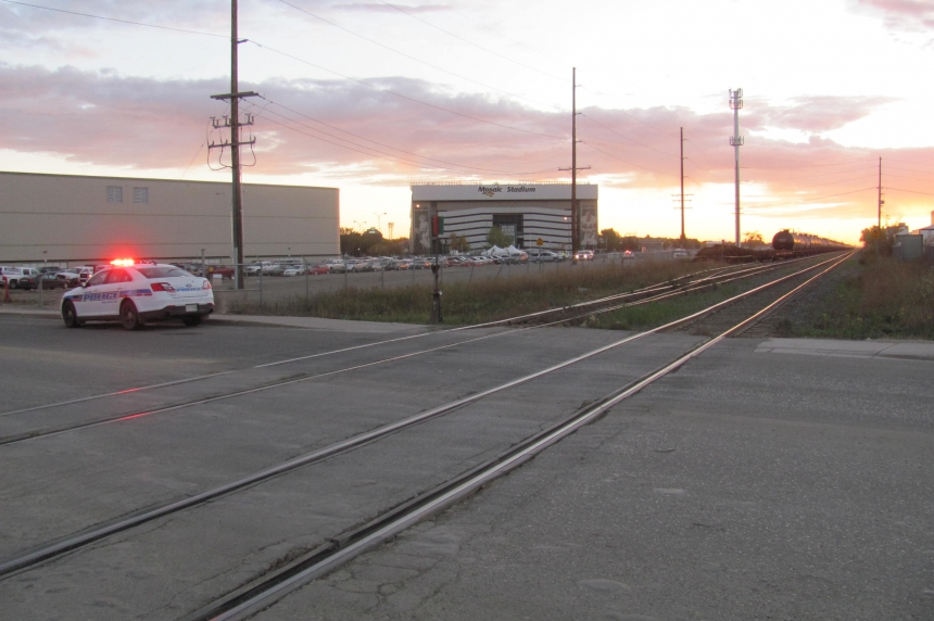 Police vehicles converge at railway tracks next to Regina's Fieldhouse