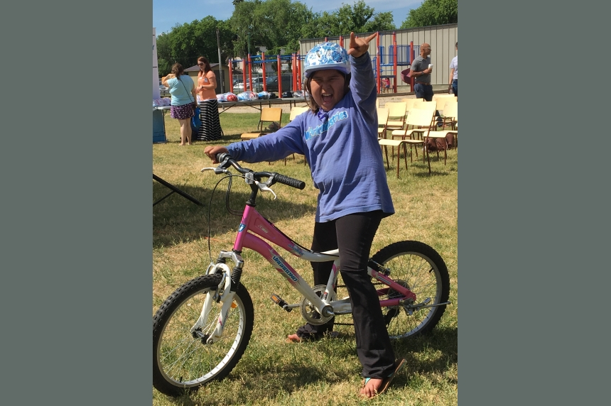 Rock 102 gives donated bicycles to kids in need