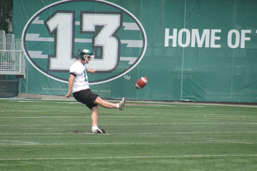 Paul McCallum kicking it in green and white again