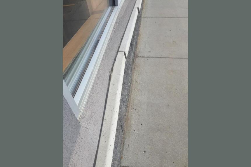 Man hurt after car drives into Saskatoon Tim Horton's