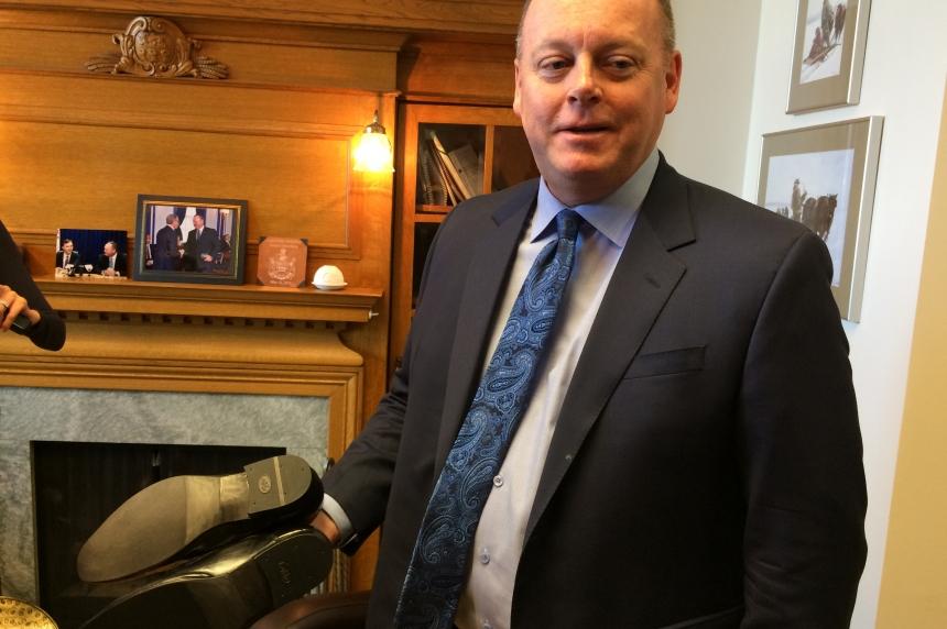 Finance minister picks resoled shoes to deliver budget
