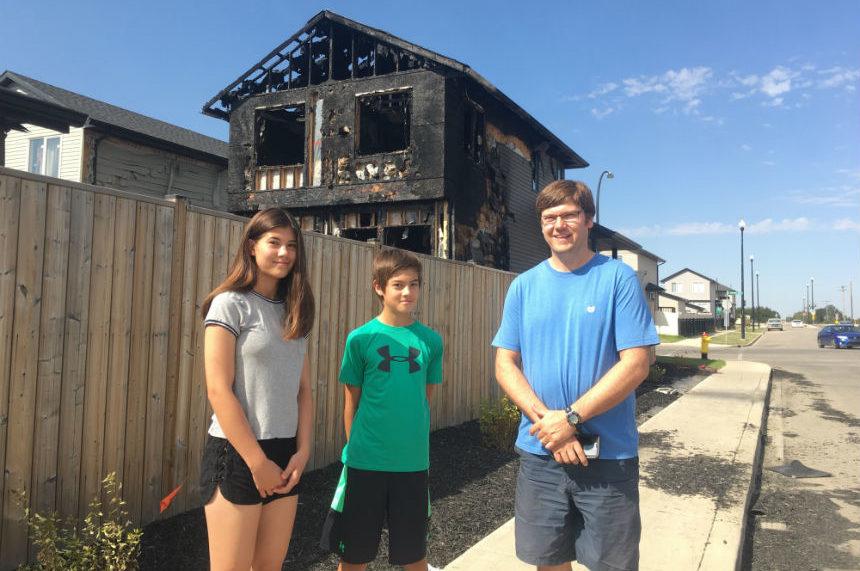 Two kids run toward danger to warn neighbours of house fire