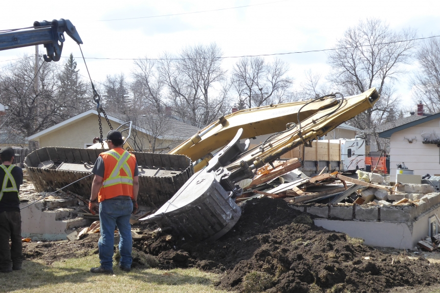 Excavator ends up in basement of home being destroyed
