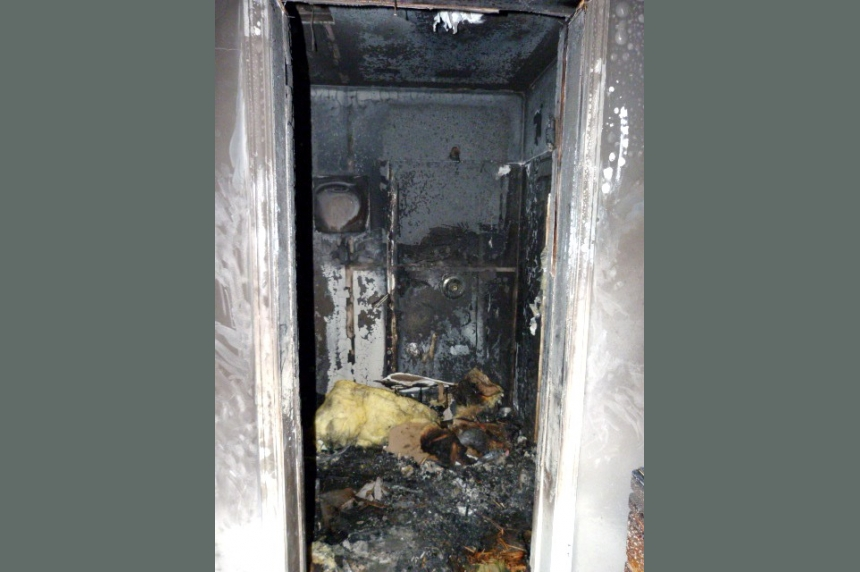 Residents wake up to smoke detector, escape house fire