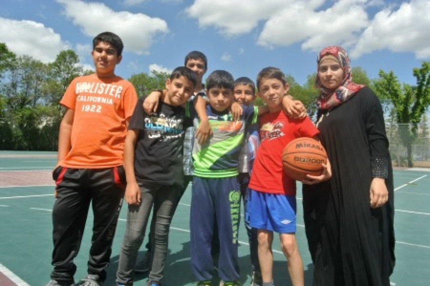 University of Regina camp for refugees splits boys and girls for swimming