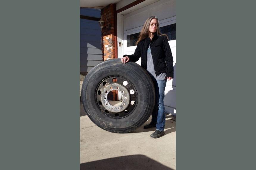 Saskatoon driver's car damaged after brush with semi tire