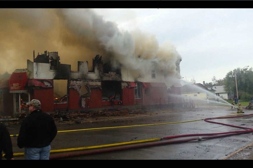 Two people charged after historic hotel near Swift Current is gutted by flames