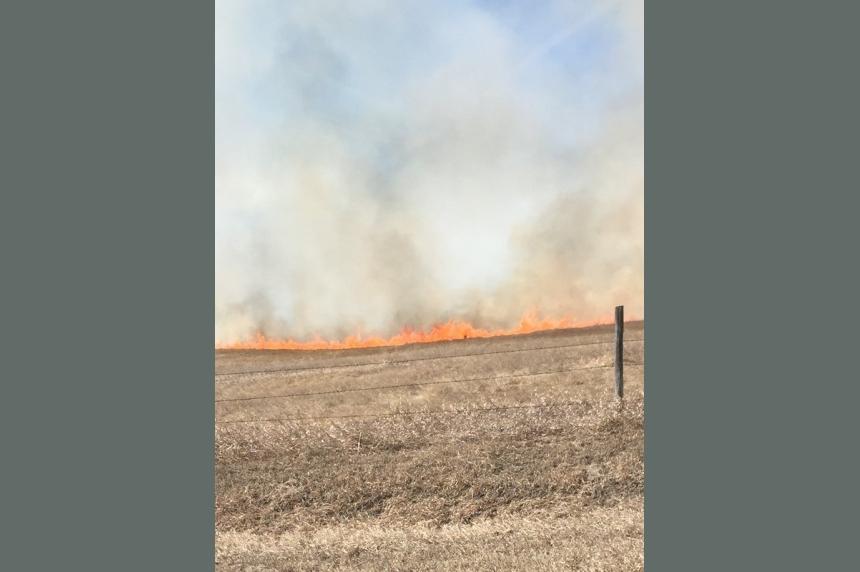 Grass fire triggers fire ban