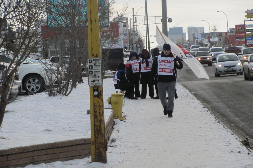 Some workers strike outside Regina hotel