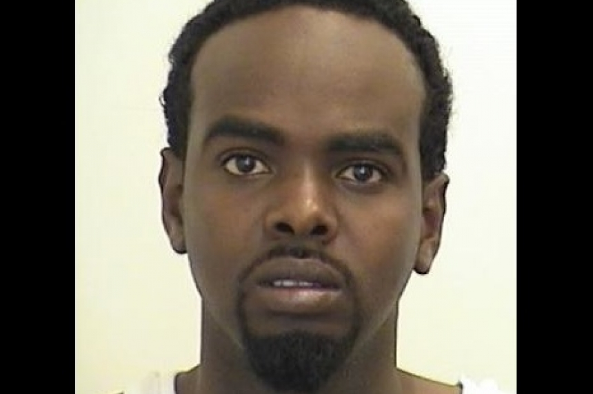 Man wanted on drug and murder charges possibly in Regina