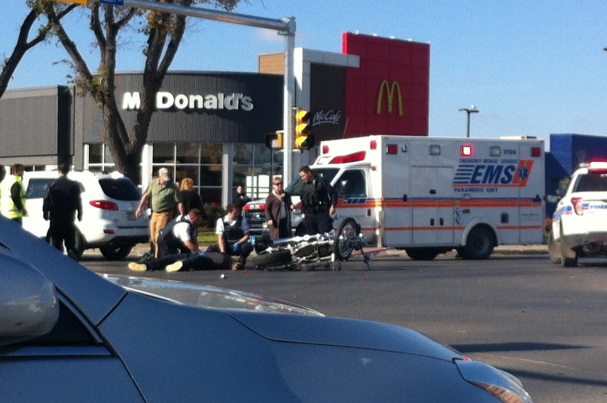 Motorcycle driver sent to hospital following crash at Albert and Dewdney