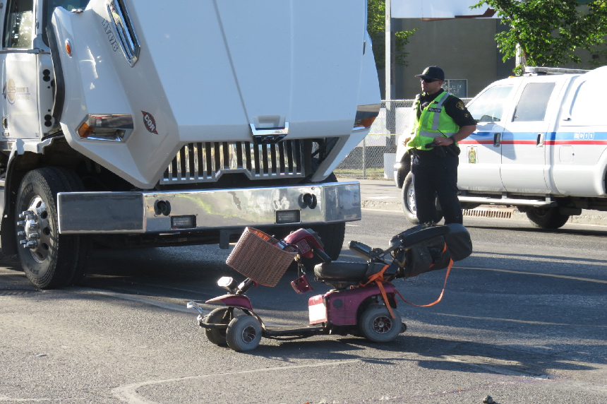 Woman killed after collision between gravel truck, scooter