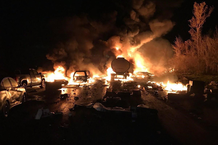 At least 2 dead in fiery highway pileup that sent drivers running for their lives