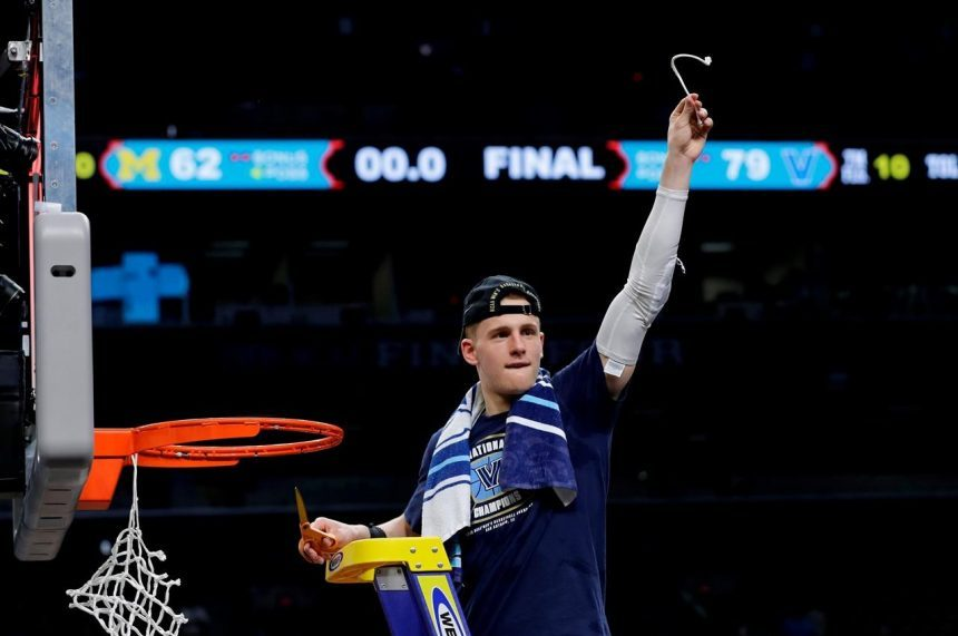 DiVincenzo makes it rain; Nova tops Michigan 79-62 for title