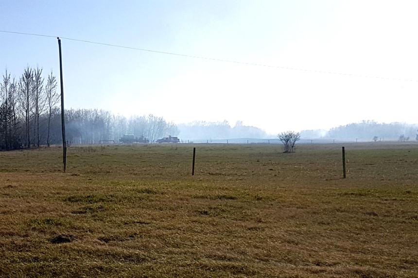 Grass fire near Clavet sends flames 40 feet high
