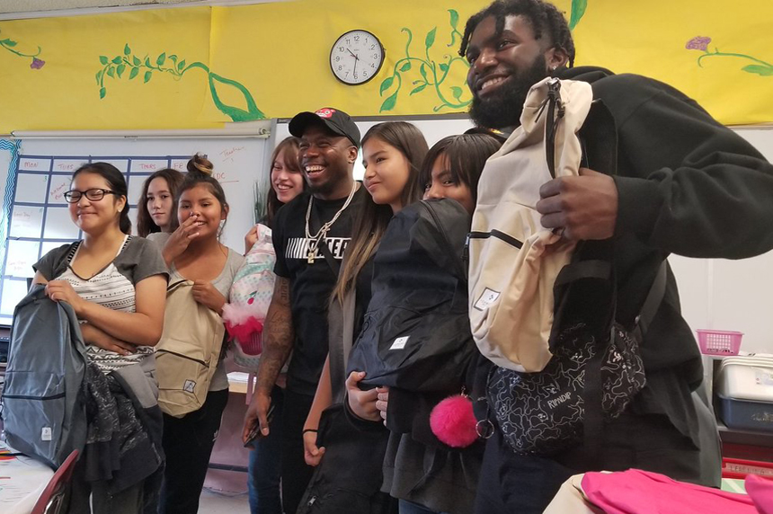 Riders' Jovon Johnson delivers back-to-school supplies