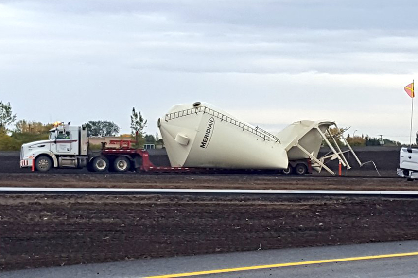 Truck hauling grain bin hits new overpass near Martensville