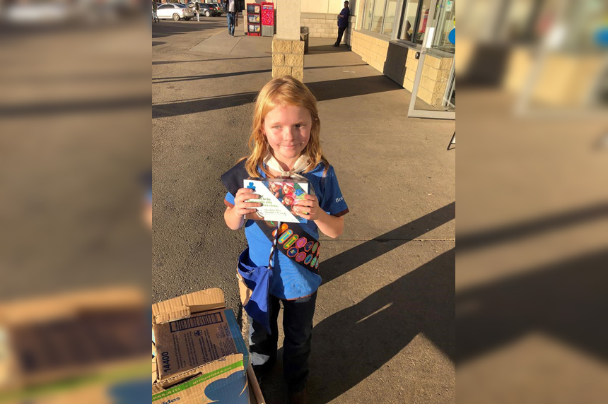 Edmonton girl guide sells out of cookies in front of cannabis store on first day