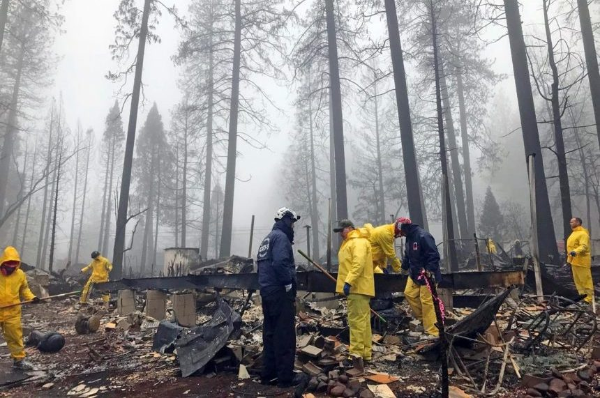 Rain helps mostly douse California fire but slows searchers