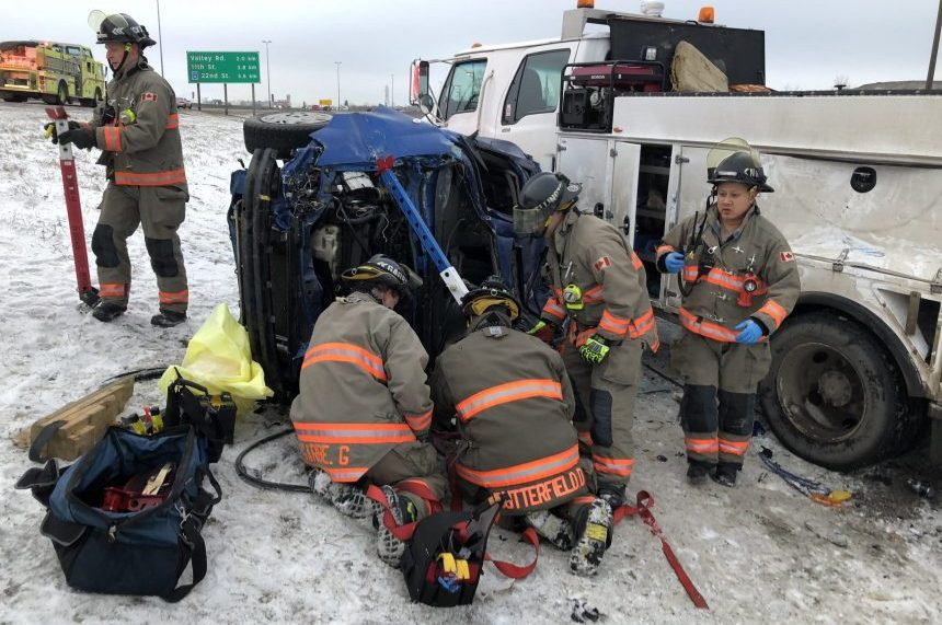 Woman extricated from vehicle after Circle Dr crash