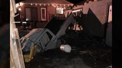 Truck Crashes into House and Pool; Driver Dies