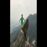 Heart-stopping moment a man fell off cliff edge after posing stunt moves for cliff-top photos