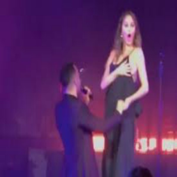 Chrissy Teigen Suffers Nip Slip As She Performs With Her Husband, John Legend On Stage