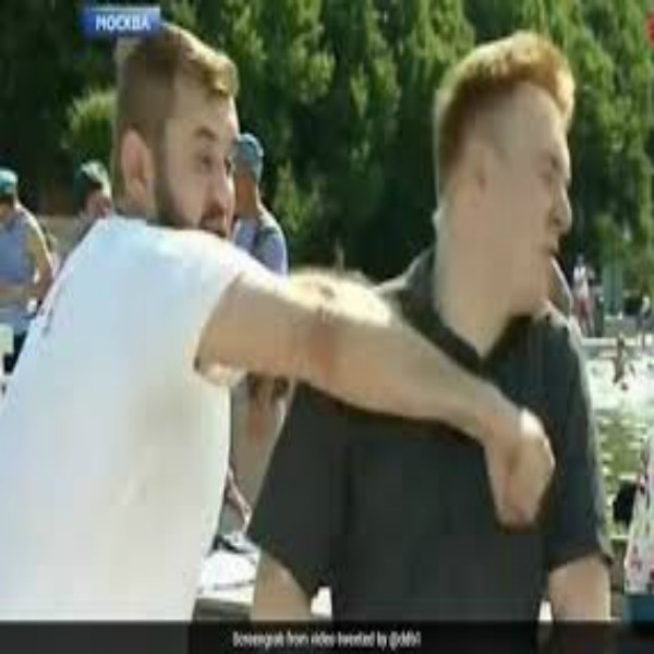 Russian Reporter Punched In Face During Live Report