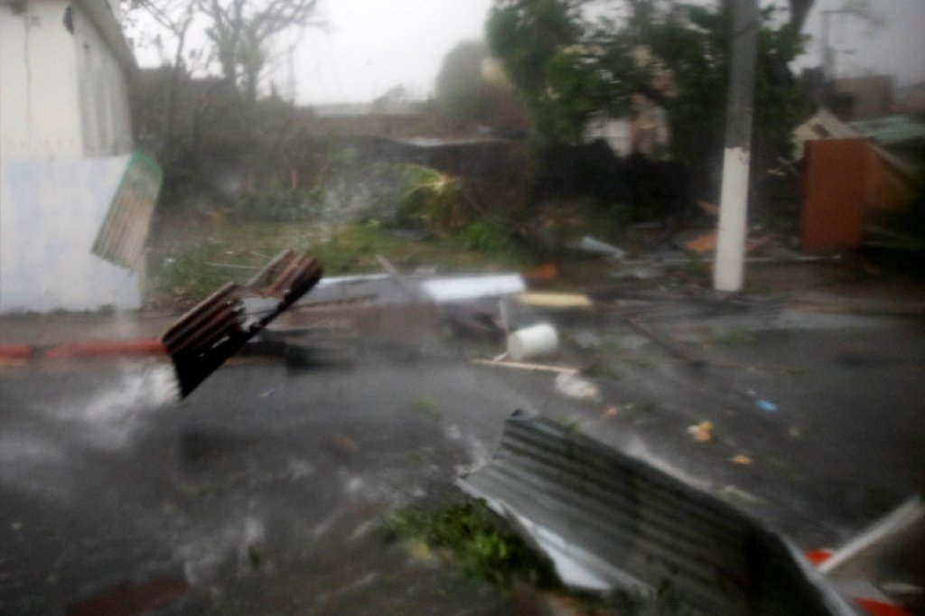 Maria Rips Across Puerto Rico, Rescuers Still Searching for Mexico Quake Survivors and Recycling Cops On The Street