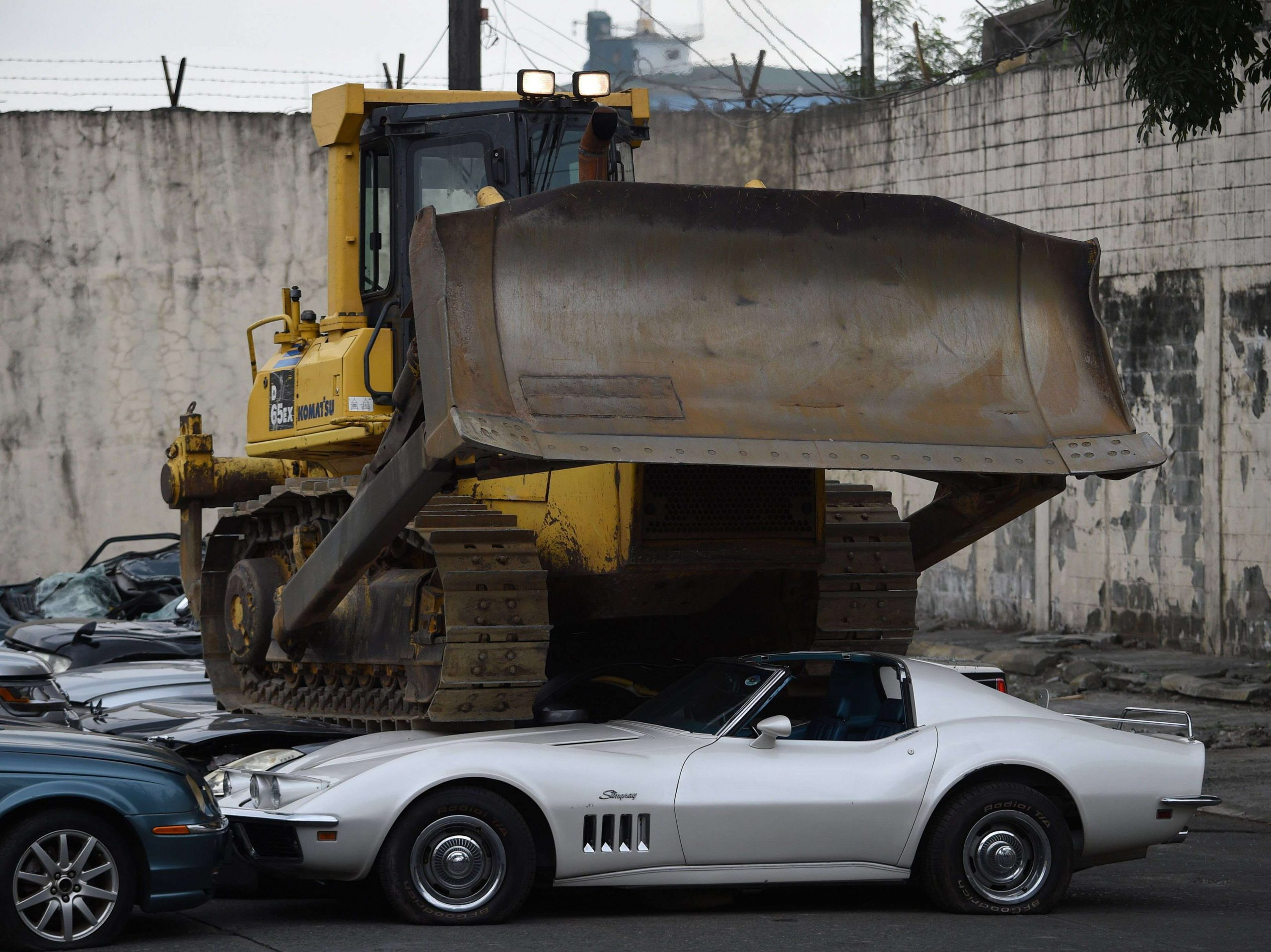 Philippines President bulldozes luxury vehicles to make anti-smuggling statement.