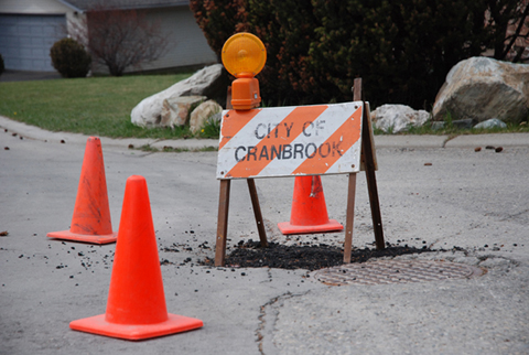 Workers repairing busy intersection in Cranbrook
