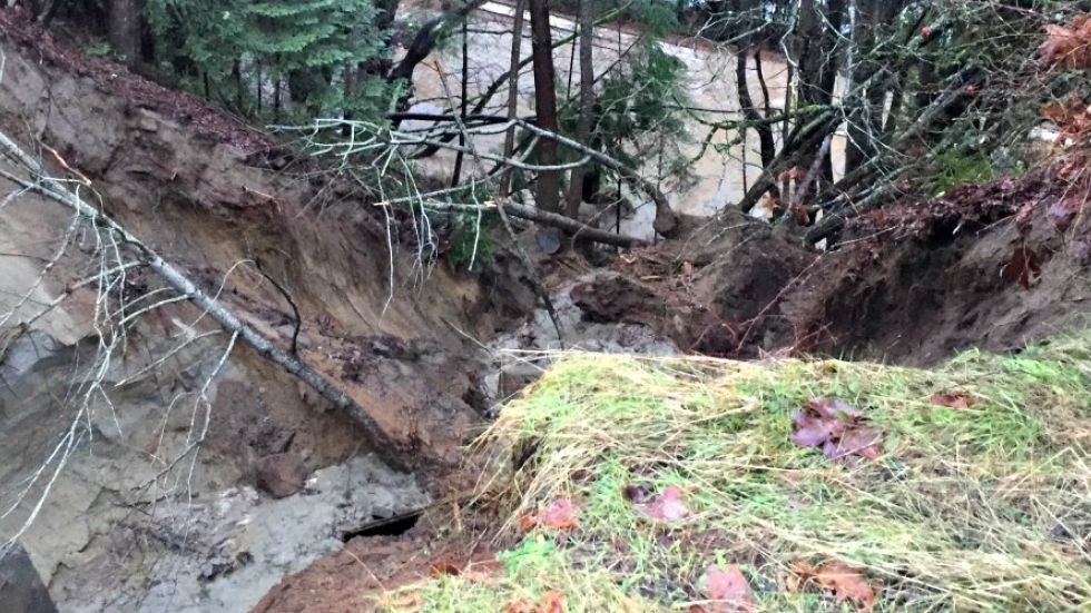 Difficult work begins to fix washed out roads after serious flooding