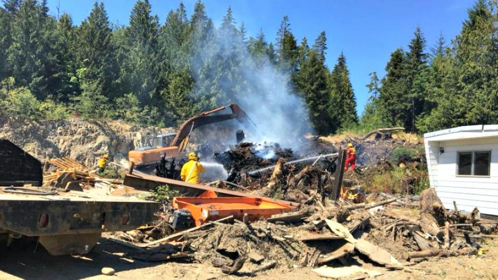 Crews snuff slash pile fire near rural Qualicum area homes