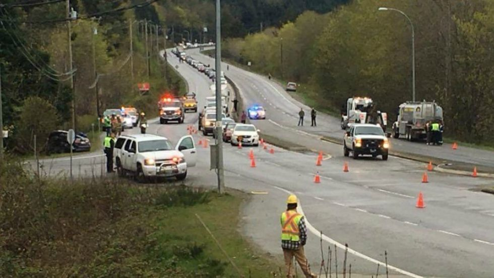 Traffic officers say suddenly crossing Island Hwy lanes caused Friday's fatal crash