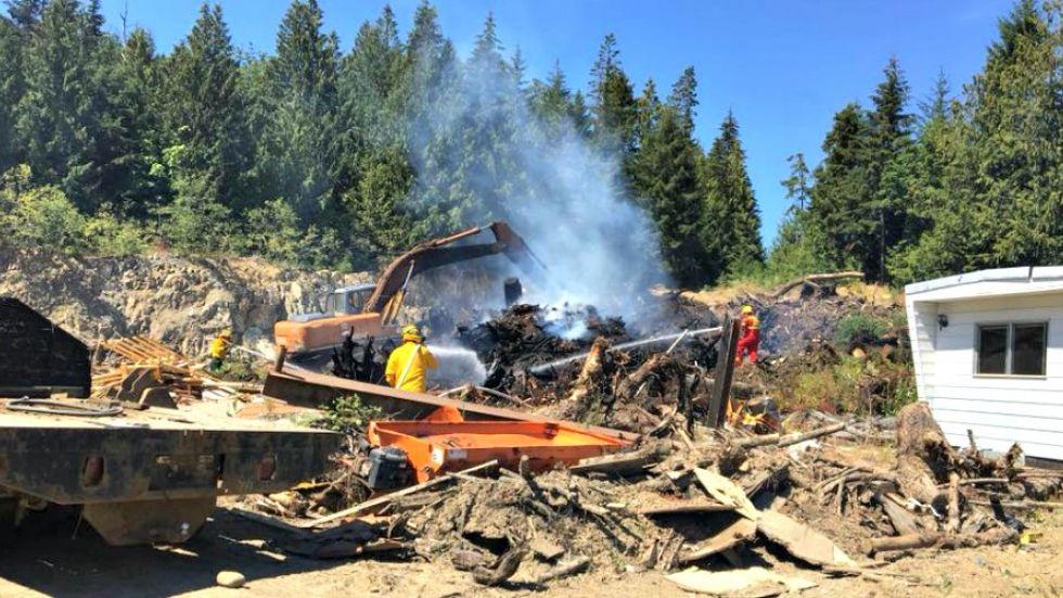 Crews snuff slash pile fire near rural Qualicum area homes