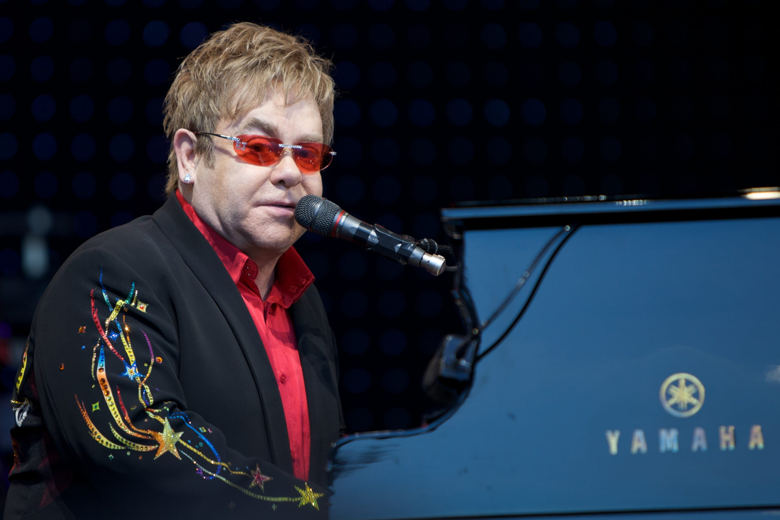 Watch Elton John Pay Tribute to his Late Mother with 'Your Song'